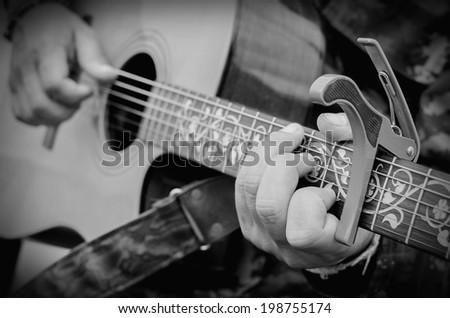 Man playing guitar, Close up shot. - stock photo