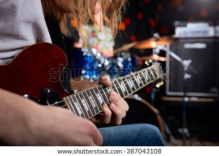 Man playing guitar. Drummer - stock photo