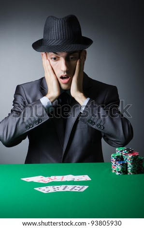 Man playing in the casino - stock photo