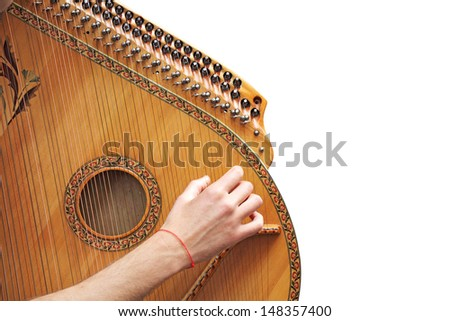 Man playing medieval lute, isolated on white background  - stock photo