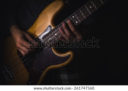 Man playing on bass guitar