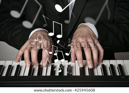 Man playing on electronic musical keyboard, close-up. - stock photo