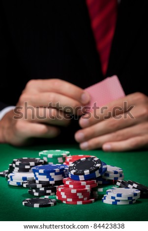 Man playing poker - stock photo