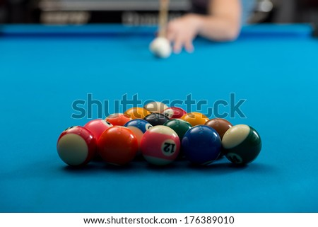 Man Playing Pool About to Hit Ball - Person Playing Billiards Lined Up To Shoot Easy Winning Shot - stock photo