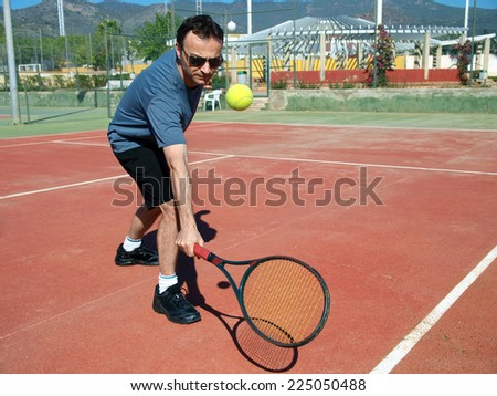 Man playing tennis - stock photo