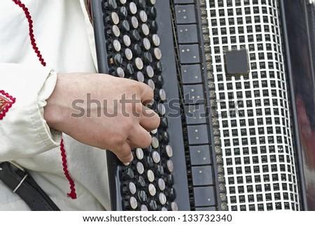 man playing the accordion - stock photo