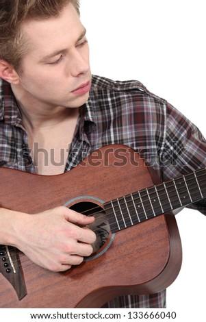 Man playing the guitar - stock photo