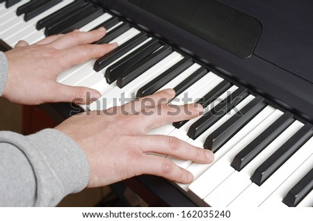 Man playing the synthesizer keyboard