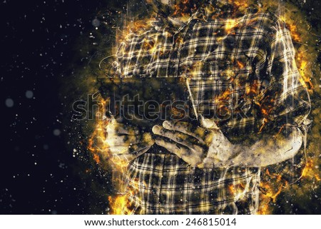 Man playing video game on digital tablet computer, conceptual toned gaming image. - stock photo