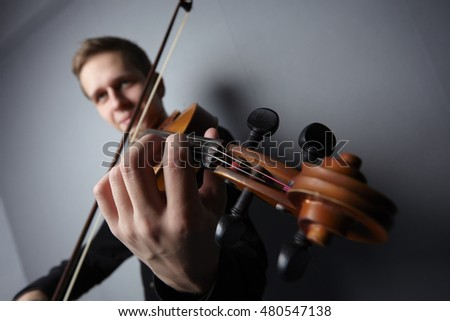 man playing violin close-up