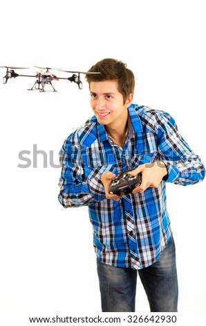 man playing with a quadcopter drone - stock photo
