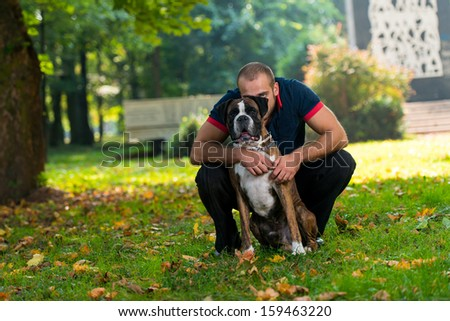 Man Playing With Dog In Park - stock photo