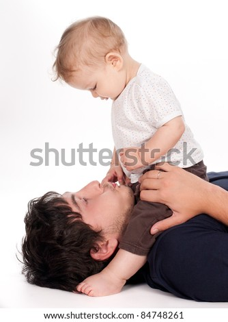 man playing with his baby on white background