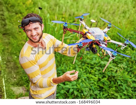 man playing with his copter - stock photo