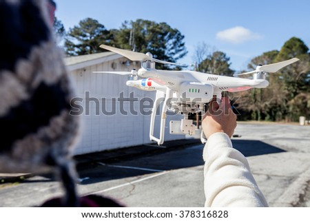 man playing with the drone