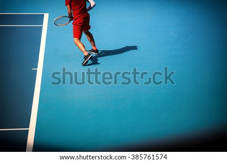 Man plays  at the tennis court - stock photo