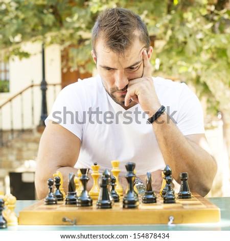 Man plays chess. - stock photo