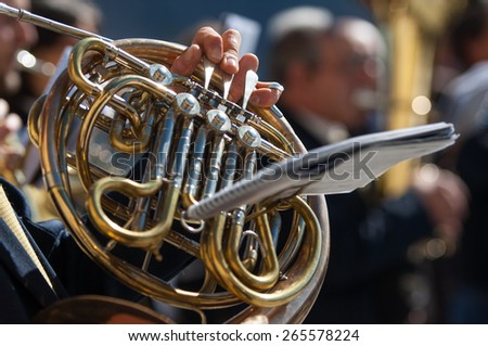 man plays the horn during a religious ceremony - stock photo