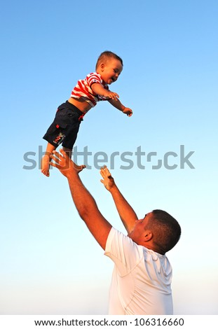 Man plays with a child