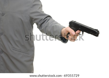 Man pointing a gun isolated on white background.
