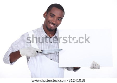 Man pointing a knife at a board left blank for your message - stock photo