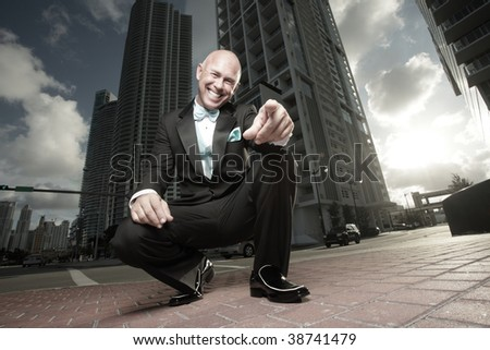 Man pointing and smiling at the camera - stock photo
