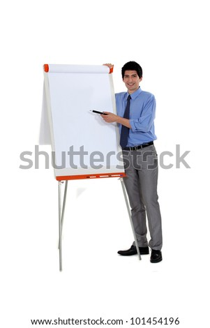 Man pointing at flip chart with pen