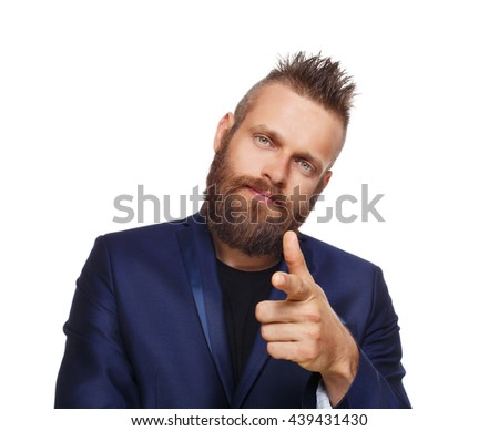 Man pointing at you. Stylish young hipster point finger isolated at white. Handsome guy in blue suit, modern businessman. Bearded male, caucasian. Business, choice concept - stock photo