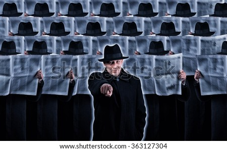 Man pointing at you while standing in front of the crowd of similar people with newspapers - stock photo
