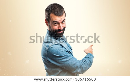 Man pointing back - stock photo
