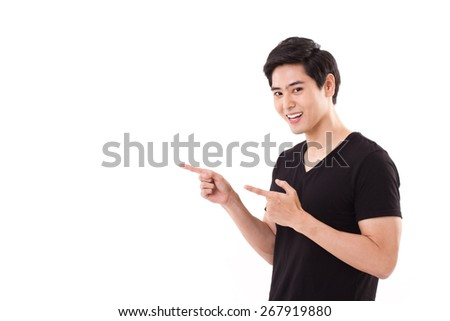 man pointing up his fingers, looking at you - stock photo