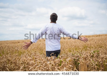 Man portrait on field background
