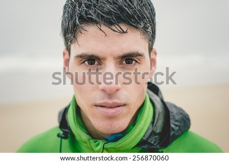 Man portrait outdoors in a rainy day - stock photo