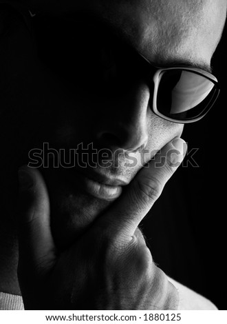 Man portrait with eyeglasses (focus in on the finger and glasses)