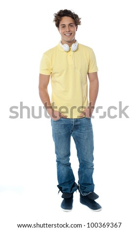 Man portrait with headphones listening to music isolated over white
