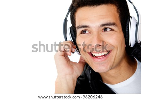 Man portrait with headphones listening to music - isolated over white - stock photo