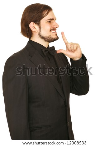 man posing as fake hitman wearing complete formal suit. isolated on white