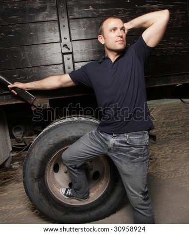 Man posing by a truck