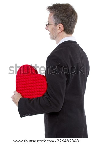 Man posing for Valentines Day or Heart Health - stock photo