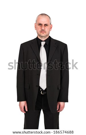 Man posing in a suit - stock photo