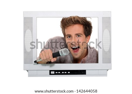 man posing on a fake television screen