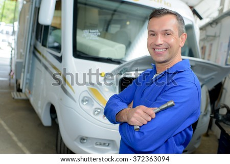 man posing with an rv