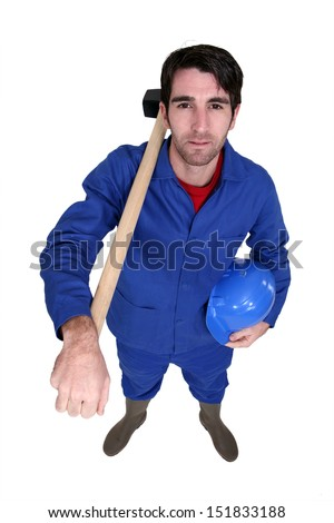 Man posing with sledge-hammer over shoulder