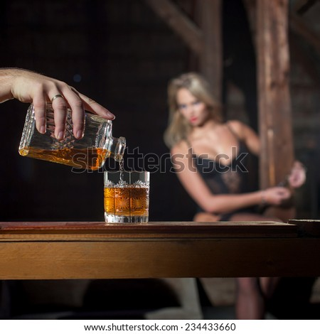 Man pour whiskey for sexy woman lover