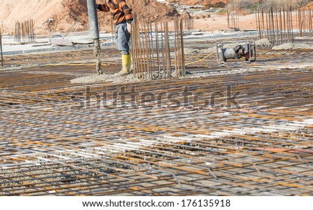Man pouring concrete directing the pump  - stock photo
