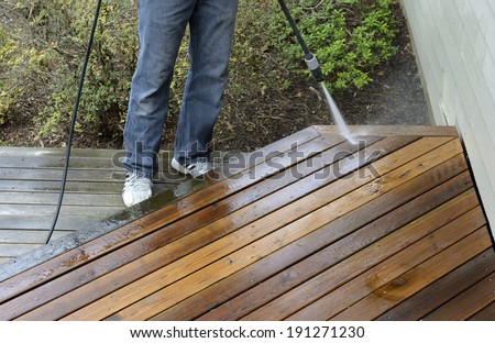 Man Power Washing Deck - stock photo
