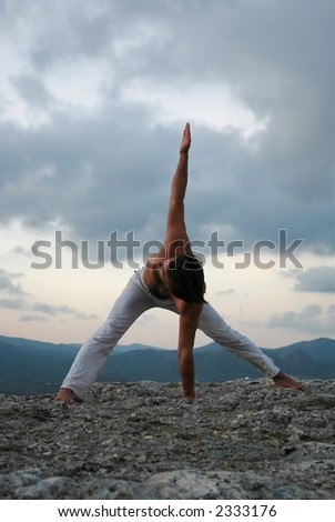 Man practi?ing hatha-yoga - stock photo