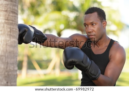 Man practicing boxing in the park
