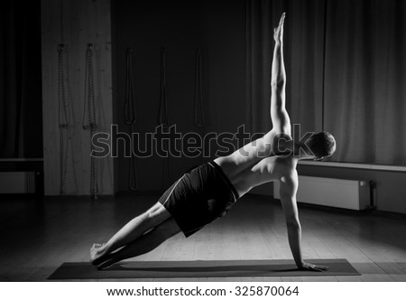 man practicing yoga in the gym - stock photo