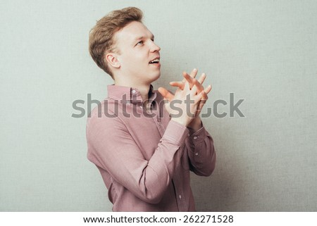 man praying and looking up - stock photo